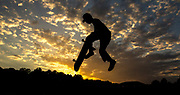 Devikiyo Brooks, 21, of Athens, Georgia, soars through the air at the Skate Park of Athens in Athens, Georgia, on Friday, April 21, 2017. Brooks, along with many of his friends, tries to skateboard every day. (Photo/Casey Sykes, www.caseysykes.com)
