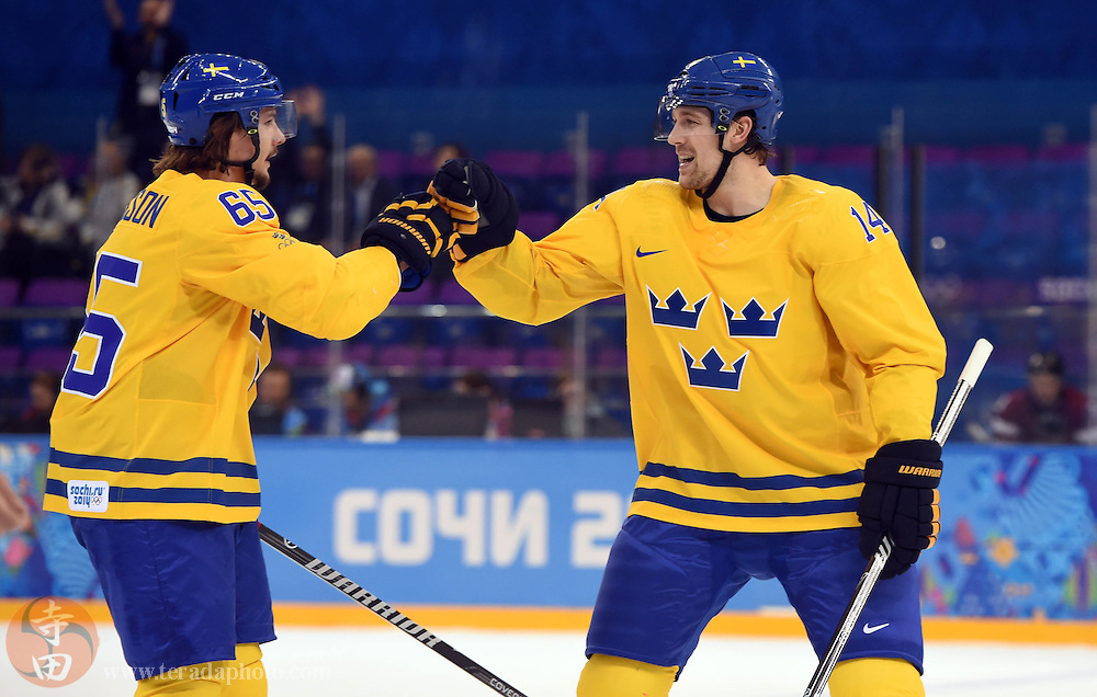 Feb 15, 2014; Sochi, RUSSIA; Sweden forward Patrick Berglund (14) celebrates with defenseman Erik Karlsson (65) after scoring a goal against Latvia in a men's preliminary round ice hockey game during the Sochi 2014 Olympic Winter Games at Shayba Arena.