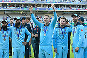 A celebrating Jos Buttler of England looks up to the players family balcony after winning the Cricket World Cup on the lap of honour during the ICC Cricket World Cup 2019 Final match between New Zealand and England at Lord's Cricket Ground, St John's Wood, United Kingdom on 14 July 2019.