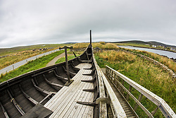 The Skidbladner (replica Gokstad ship), and the Viking Longhouse reconstruction, both located at Haroldswick with the Viking Unst, Unst, Shetland.