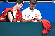 Sopot, Poland - 2018 April 08: (L) Hubert Hurkacz and (R) Michal Przysiezny both from Poland look at the cell phone while Men's Single Match Nr 4 during Poland v Zimbabwe Tie Group 2, Europe/Africa Second Round of Davis Cup by BNP Paribas at 100 years of Sopot Hall on April 08, 2018 in Sopot, Poland.<br /> <br /> Mandatory credit:<br /> Photo by © Adam Nurkiewicz / Mediasport<br /> <br /> Adam Nurkiewicz declares that he has no rights to the image of people at the photographs of his authorship.<br /> <br /> Picture also available in RAW (NEF) or TIFF format on special request.<br /> <br /> Any editorial, commercial or promotional use requires written permission from the author of image.
