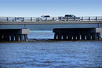 Swansboro traffic rolls along the Highway 24 bridge over White Oak River.