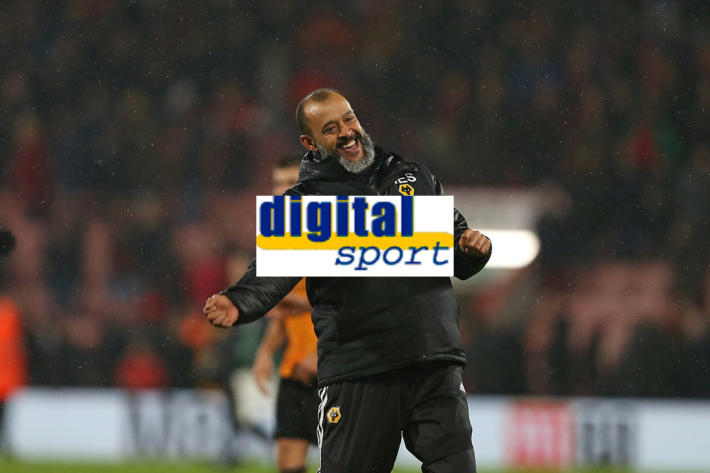 Football - 2019 / 2020 Premier League - AFC Bournemouth vs. Wolverhampton Wanderers<br /> <br /> Wolverhampton Wanderers Head Coach Nuno Espirito Santo celebrates after the final whistle with the traveling Wolves fans at the Vitality Stadium (Dean Court) Bournemouth <br /> <br /> COLORSPORT/SHAUN BOGGUST
