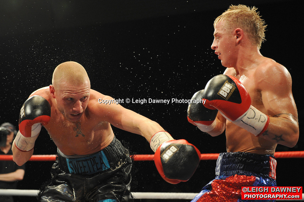 Gary Sykes (blue shorts) defeats Kevin O'Hara for the British Super-Featherweight Title at Huddersfield Leisure Centre on 28th May 2010. Frank Maloney Promotions. Photo credit: © Leigh Dawney