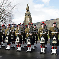 Black Watch Homecoming Parade, Aberfeldy. 02.03.05<br />Black Watch soldiers line up in front of the Black watch Memorial.<br />Two guards of a hundred men each from The 1st Battalion The Black Watch marched through Aberfeldy, Perthshire led by the Pipes and Drums also of the 1st Battalion The Black Watch. Aberfeldy is where the 'Companies' of men were mustered in 1667, the dark tartans that the men wore to distinguish them from the 'Red Soldiers' led them to becoming known as 'Freiceadan Dubh' or 'The Black Watch'<br />The Black Watch memorial in Aberfeldy was unveiled on the 14th November 1887 by Gavin - Marquis of Breadlabane.<br />Picture by Graeme Hart.<br />Copyright Perthshire Picture Agency<br />Tel: 01738 623350  Mobile: 07990 594431