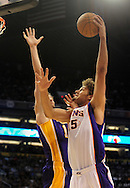 Oct. 29 2010; Phoenix, AZ, USA; Phoenix Suns forward-center Robin Lopez (15) puts up a basket against Los Angeles Lakers forward-center Pau Gasol (16) during the first quarter at the US Airways Center. Mandatory Credit: Jennifer Stewart-US PRESSWIRE.