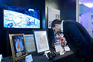 Garden City, New York, U.S. November 14, 2019. Man looks at items on display at the Silent Auction fundraiser area during the 17th Annual Cradle of Aviation Museum Air and Space Gala.