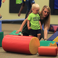Kelsey Edwards, of Pontotoc, helps her son Abram, 2, with the building block as they play in the Zoom Room at HealthWorks as part of Fun and Fit Friday. The camp is for children and their adult relatives where they have story time, crafts and an obstacle course in the Zoom Room.