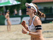STARE JABLONKI POLAND - July 3: Nadine Zumkehr /1/ of Switzerland in action during Day 3 of the FIVB Beach Volleyball World Championships on July 3, 2013 in Stare Jablonki Poland.  (Photo by Piotr Hawalej)