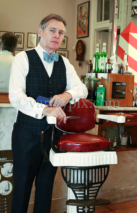 26 October 2014. New Orleans, Louisiana. <br /> New Orleans' bespoke gentlemen's barber  Aidan Gill<br /> Photo; Charlie Varley/varleypix.com