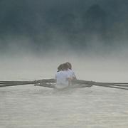 Indiana University women rowing crew team at Lake Lemon, Bloomington, Indiana.