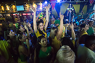 Brazilians celebrate Brazil's winning goal in the Brazil v Croatia match in a bar in Manaus next to the Arena da Amazonia, Manaus, Brazil. As well as Brazilians there were numerous England fans watching the game there as well. <br /> Picture by Andrew Tobin/Focus Images Ltd +44 7710 761829<br /> 12/06/2014