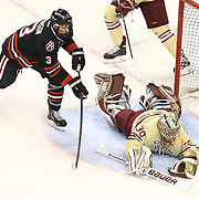 Josh Manson #3 of the Northeastern Huskies tries to get the puck from Thatcher Demko #30 of the Boston College Eagles during The Beanpot Championship Game at TD Garden on February 10, 2014 in Boston, Massachusetts. (Photo by Elan Kawesch)