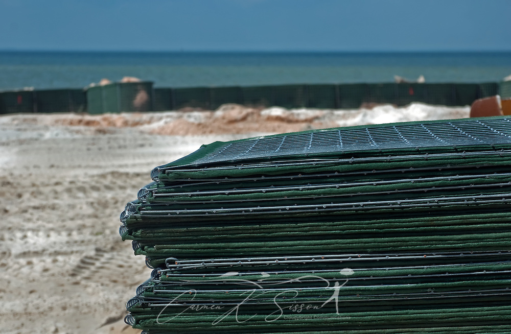 HESCO barriers lie stacked on west end of Dauphin Island, Alabama, where efforts to protect the island from oil threatening as a result of the Deepwater Horizon rig explosion earlier in the month were heavily underway May 7, 2010. The National Guard spent most of the day installing nearly four miles of the felt-like boxes (seen in the background) and filling them with sand chemically treated to transform the oil into a solid which can be safely removed. (Photo by Carmen K. Sisson/Cloudybright)