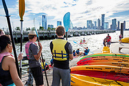 Kayackers wait in line at Downtown Boathouse on the lower west side of Manhattan at Pier 26