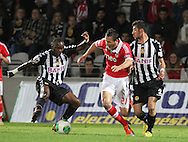 Portugal, FUNCHAL : Nacional´s Angolan forward Mateus (L )  vies with Benfica's Serbian midfielder Matic (r) during Portuguese League football match Nacional vs Benfica at Madeira Stadium in Funchal on February 10, 2013.  PHOTO/ GREGORIO CUNHA..