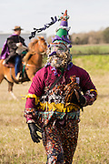 A reveler carries the chicken he just caught during the traditional Cajun Courir de Mardi Gras chicken run on Fat Tuesday February 17, 2015 in Eunice, Louisiana. Cajun Mardi Gras involves costumed revelers competing to catch a live chicken as they move from house to house throughout the rural community.