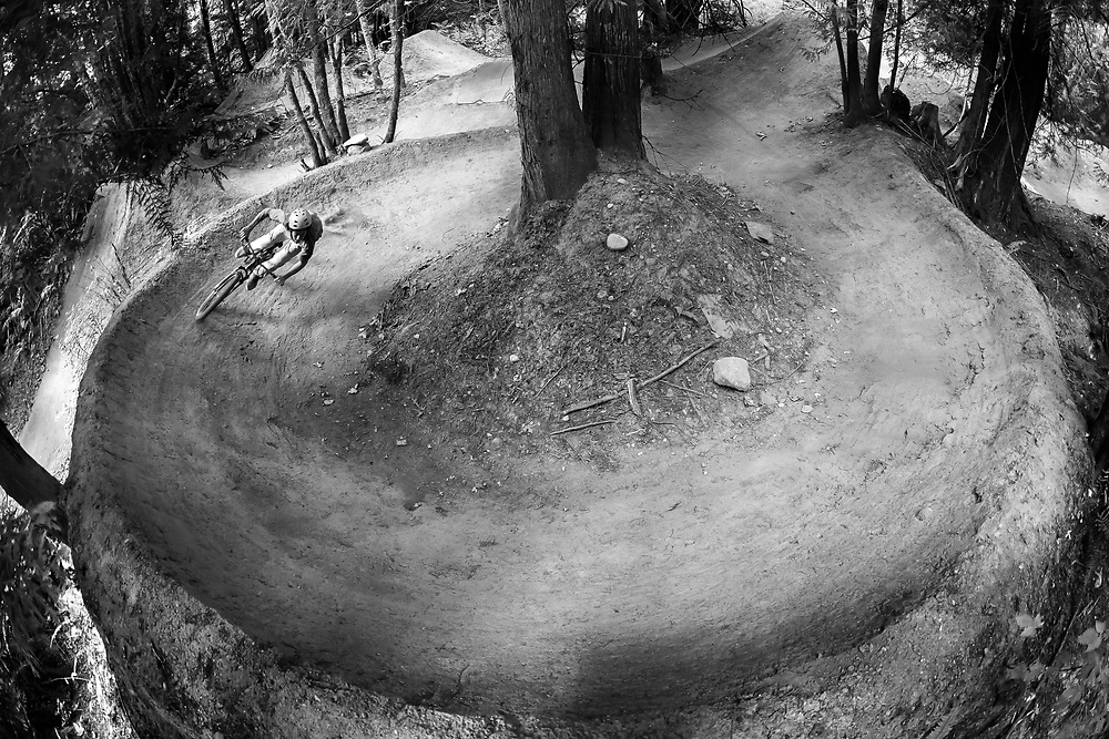 Zaid Elgawarsha and Andy Grant ride a circle burm in Bellingham Washington.