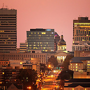 The South Carolina statehouse and skyline is seen at night in downtown Columbia, S.C. Also pictured is The University of South Carolina and the BB&T, NBSC, and Bank of America buildings. At bottom left is the top of California Dreaming, an American-style restaurant that was once a train station. This is a view of Main St. looking north. ©Travis Bell Photography
