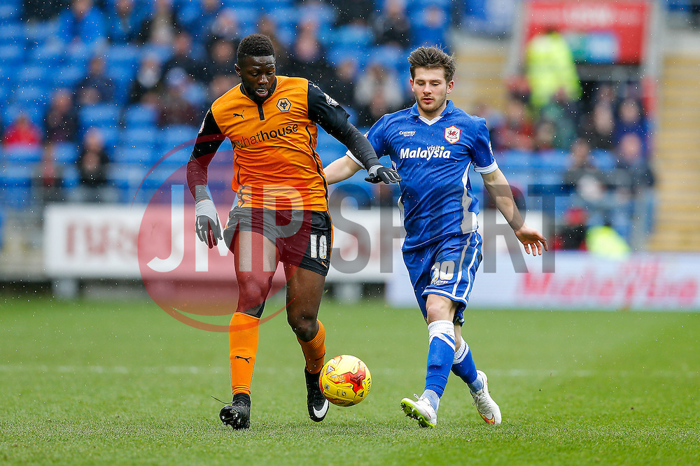 Bakary Sako of Wolverhampton Wanderers and Matthew Kennedy of Cardiff City compete - Photo mandatory by-line: Rogan Thomson/JMP - 07966 386802 - 28/02/2015 - SPORT - FOOTBALL - Cardiff, Wales - Cardiff City Stadium - Cardiff City v Wolverhampton Wanderers - Sky Bet Championship.