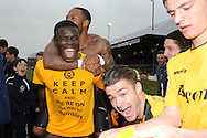 Newport county players Ismail Yakubu ©, Aaron O'Connor and Andrew Hughes (r) celebrate their win as they book their place in the Wembley final. Blue square bet premier div, play off semi final match, 2nd leg, Newport county v Grimsby Town at Rodney Parade in Newport, South Wales on Sunday 28th April 2013. pic by Andrew Orchard,  Andrew Orchard sports photography,