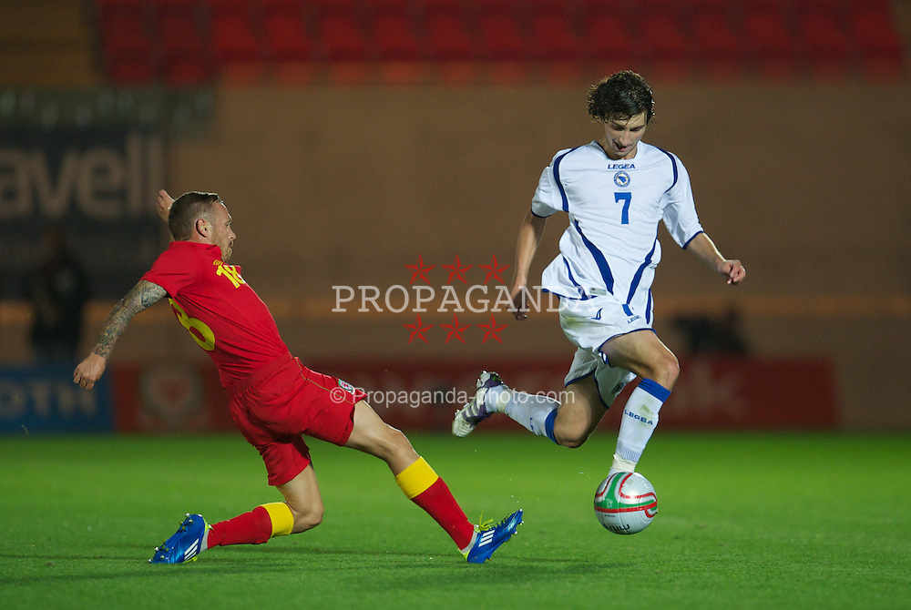 LLANELLI, WALES - Wednesday, August 15, 2012: Bosnia-Herzegovina's Miroslav Stevanovic and Wales' Craig Bellamy during the international friendly match at Parc y Scarlets. (Pic by David Rawcliffe/Propaganda)
