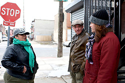 Local residents Gloria Cartagena, Daniel Derrah and Dina Richman stand on the jasper Street and Somerset corner in the Kensington section of Philadelphia, PA, on March 25, 2018. (Bastiaan Slabbers for WHYY)