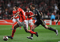 20100401: LISBON, PORTUGAL - SL Benfica vs Liverpool: Europa League 2009/2010 - Quarter-Finals - 1st leg. In picture: Angel Di Maria (Benfica) and Lucas (Liverpool). PHOTO: Alvaro Isidoro/CITYFILES