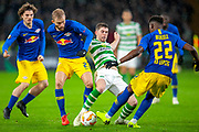 Ryan Christie (#17) of Celtic FC is stopped by Konrad Laimer (#27) of RB Leipzig and Nordi Mukiele (#22) of RB Leipzig during the Europa League group stage match between Celtic and RP Leipzig at Celtic Park, Glasgow, Scotland on 8 November 2018.