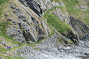 Hikers explore Måstad or Mostad, a village in the Lofoten archipelago, Norway.