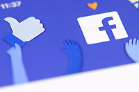 Facebook app front page logo on the screen of a mobile device