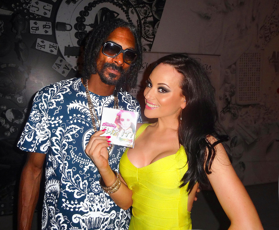 Charlotte Devaney and Snoop Dogg backstage after preforming at a club in Marbella on 11th August 2013.