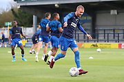 AFC Wimbledon attacker Shane McLoughlin (19) warming up during the EFL Trophy (Leasing.com) match between AFC Wimbledon and U23 Brighton and Hove Albion at the Cherry Red Records Stadium, Kingston, England on 3 September 2019.