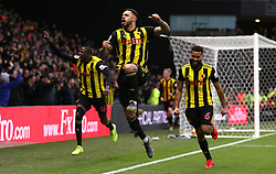 Watford's Andre Gray (centre) celebrates scoring his side's first goal of the game with team mates during the Premier League match at Vicarage Road, Watford.
