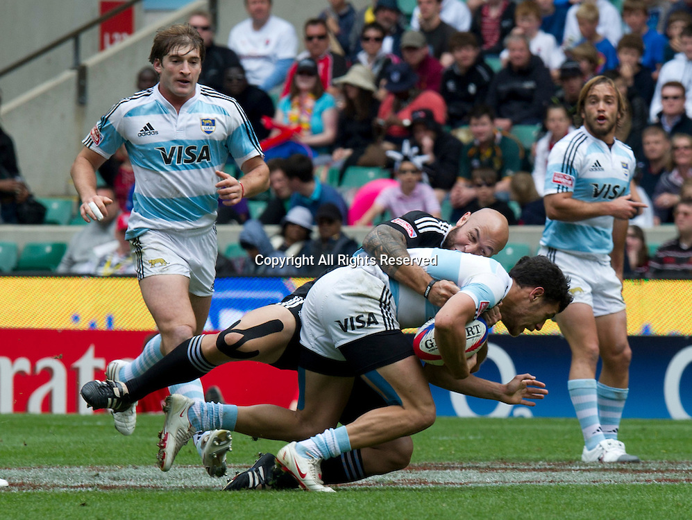 22.05.2011  DJ Forbes (NZL) makes a tackle at the Rugby Union HSBC Sevens World Series from Twickenham.