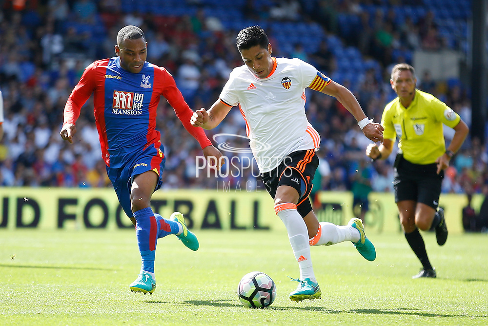 Crystal Palace midfielder Jason Puncheon (42) chases down Valencia midfielder Enzo Perez during the Pre-Season Friendly match between Crystal Palace and Valencia CF at Selhurst Park, London, England on 6 August 2016. Photo by Andy Walter.