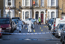 © Licensed to London News Pictures. 30/09/2017. London, UK. Police forensics officers gather evidence after a man was fatally stabbed in Bow, East London. Police were called at 2:30 am on Saturday, 30 September to reports of a disturbance in E3. Officers found a 21-year-old man suffering from stab injuries. He was treated at the scene by London's Air Ambulance before being taken to an east London hospital where he died. Detectives from the Homicide and Major Crime Command are investigating. Photo credit: Peter Macdiarmid/LNP