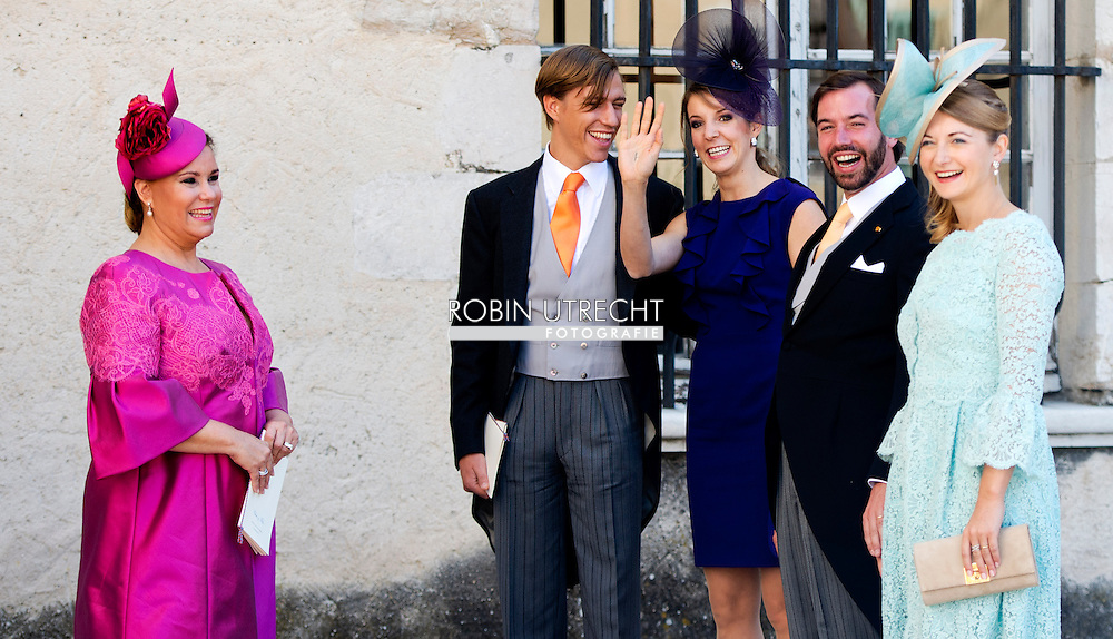 21-09-2013 - Saint-Maximin-La-Sainte-Baume - Grand Duke Henri of Luxembourg (R) and Grand Duchess Maria Teresa of Luxembourg Prince Felix of Luxembourg (R) and his wife German student Claire Lademacher leave the church after their religious wedding ceremony on September 21, 2013 at the Saint Mary Magdalene Basilica in Saint-Maximin-La-Sainte-Baume, southern France.  COPYRIGHT ROBIN UTRECHT