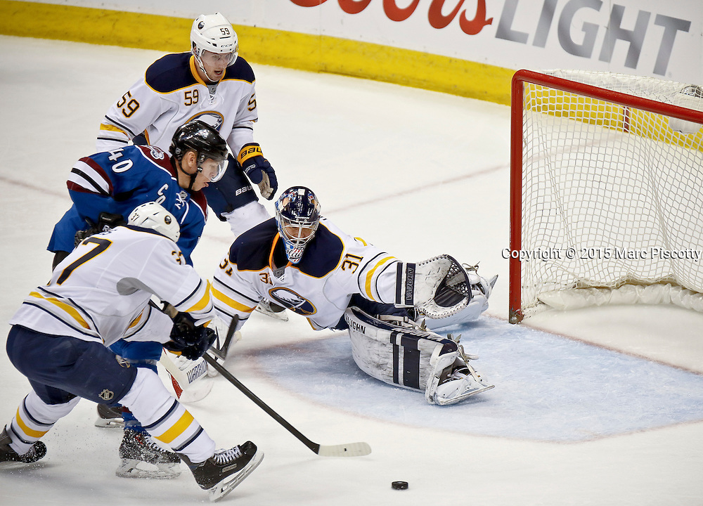 SHOT 3/28/15 8:16:43 PM - The Colorado Avalanche's Alex Tanguay #40 looks to score in front of the Buffalo Sabres' Matt Hackett #31, Matt Ellis #37 and Tim Schaller #59 during their regular season NHL game at the Pepsi Center in Denver, Co. The Avalanche won the game 5-3. (Photo by Marc Piscotty / © 2015)