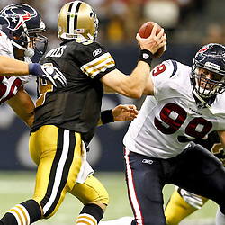 September 25, 2011; New Orleans, LA, USA; New Orleans Saints quarterback Drew Brees (9) is pressured by Houston Texans defensive end J.J. Watt (99) and linebacker Brian Cushing (56) during the third quarter at the Louisiana Superdome. The Saints defeated the Texans 40-33. Mandatory Credit: Derick E. Hingle