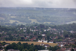 © Licensed to London News Pictures. 30/06/2020. Surrey, UK. Mist gathers over Dorking in the Surrey Hills as the midsummer rain continues to fall with weather forecasters predicting a mild but windy and wet week ahead for the South East. Photo credit: Alex Lentati/LNP