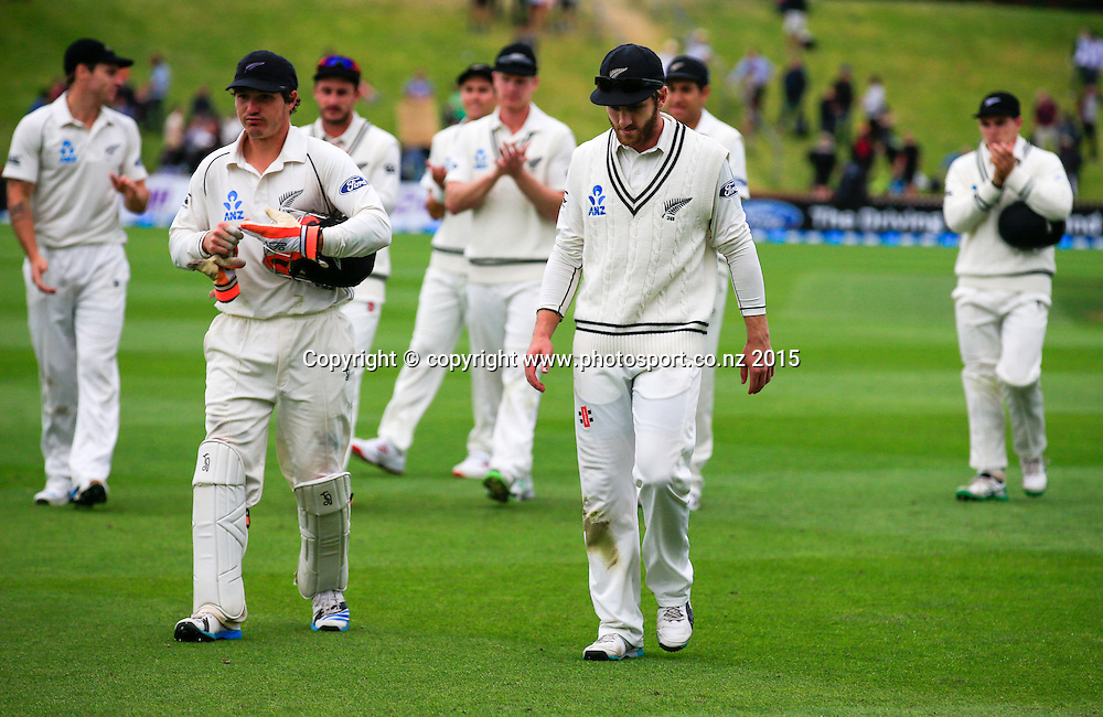 BJ Watling and Kane Williamson lead New Zealand off the field. Fourth day, second test, ANZ Cricket Test series, New Zealand Black Caps v Sri Lanka, 06 January 2015, Basin Reserve, Wellington, New Zealand. Photo: John Cowpland / www.photosport.co.nz