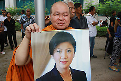 July 21, 2017 - Thailand - Monk supporters hold picture of Yingluck Shinawatra, Former Thai Prime Minister at the Supreme Court in Bangkok during a final court hearing  expected in the negligence trial of ousted Yingluck, who faces up to a decade in jail in a case lambasted by her supporters as politically motivated. (Credit Image: © Vichan Poti/Pacific Press via ZUMA Wire)