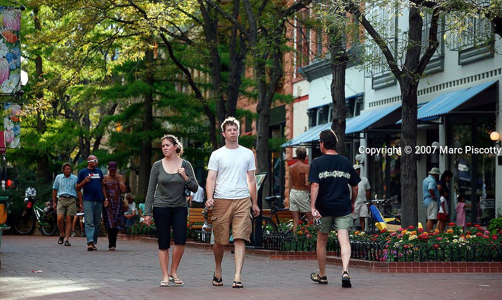SHOT 8/12/2007 - The Pearl Street Mall is one of Boulder, Co.'s most treasured landmarks, this outdoor pedestrian mall boasts an array of boutiques and shops peddling an assortment of goods, from music to kites to trendy clothing. Located in the heart of Boulder, the tree lined, brick walkway is closed to motor traffic and also features a regular host of street performers and unusual Boulder characters..(Photo by Marc Piscotty © 2007)