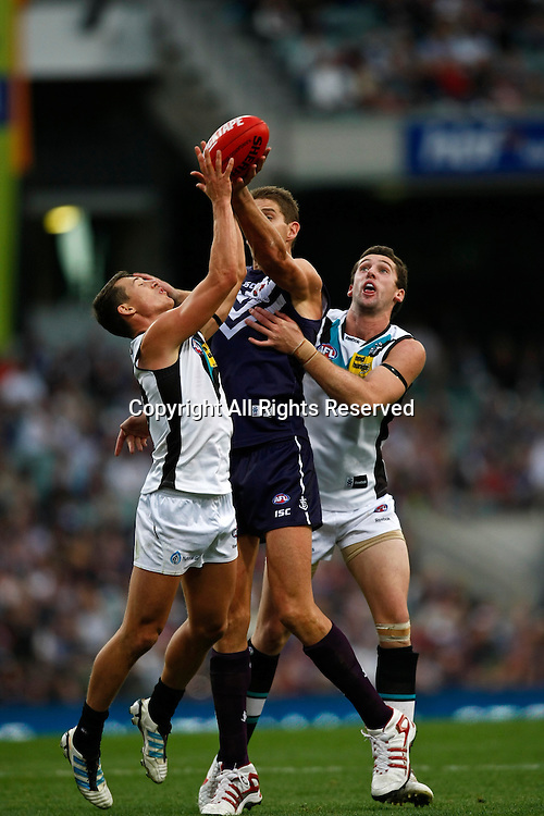 13.05.2012 Subiaco, Australia. Fremantle v Port Adelaide. Aaron Sandilands battles against two Port Adelaide players during the Round 7 game played at Patersons Stadium.