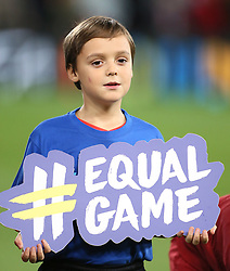A mascot holds up an equal game sign