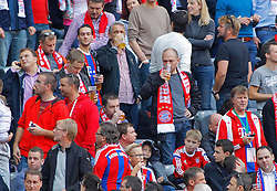 MUNICH, GERMANY - OCTOBER 18: Bayern Munich fans enjoy a beer  during the Bundesliga match between Bayern Munich and Werder Bremen. October 18, 2014 in Munich, Germany. Photo mandatory by-line: Mitchell Gunn