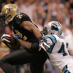 2008 December, 28: New Orleans Saints wide receiver Marques Colston (12) pulls Carolina Panthers safety Chris Harris (43) into the endzone for a first half touchdown during a week 17 game between NFC South divisional rivals the Carolina Panthers and the New Orleans Saints at the Louisiana Superdome in New Orleans, LA.