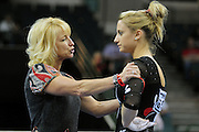 University of Utah co-head coach Megan Marsden, left, talks with freshman Mary Beth Lofgren before her balance beam routine at the 2011 Women's NCAA Gymnastics Championship Individual Event Finals on April 17, in Cleveland, OH. Lofgren tied for fifth place. (photo/Jason Miller)
