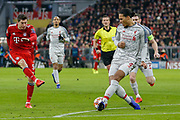 Bayern Munich forward Robert Lewandowski (9) shoots and Liverpool defender Virgil van Dijk (4) blocks during the Champions League match between Bayern Munich and Liverpool at the Allianz Arena, Munich, Germany, on 13 March 2019.